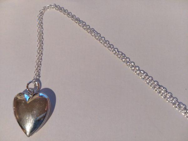 conjunto colgante y pendientes corazon